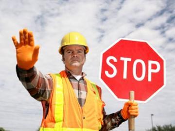 bouwvakker met stopbord
